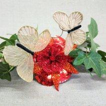 Bijou de tête fleur rouge et papillons dorés